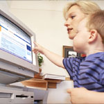 Image of a woman and a child in front of a computer