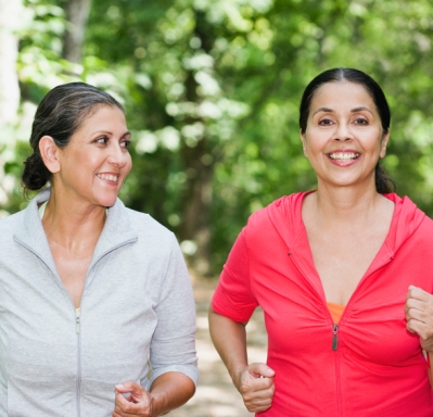 Two older women jogging