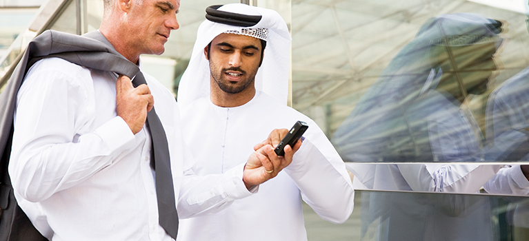 A businessman showing cell phone