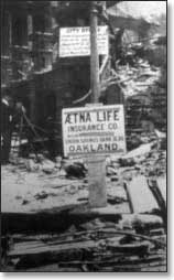Black and white image of pole with an Aetna sign on it