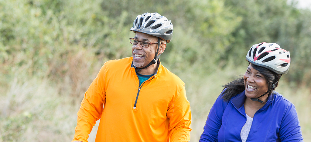 Couple riding their bikes and smiling