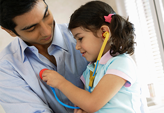 child playing with stethoscope