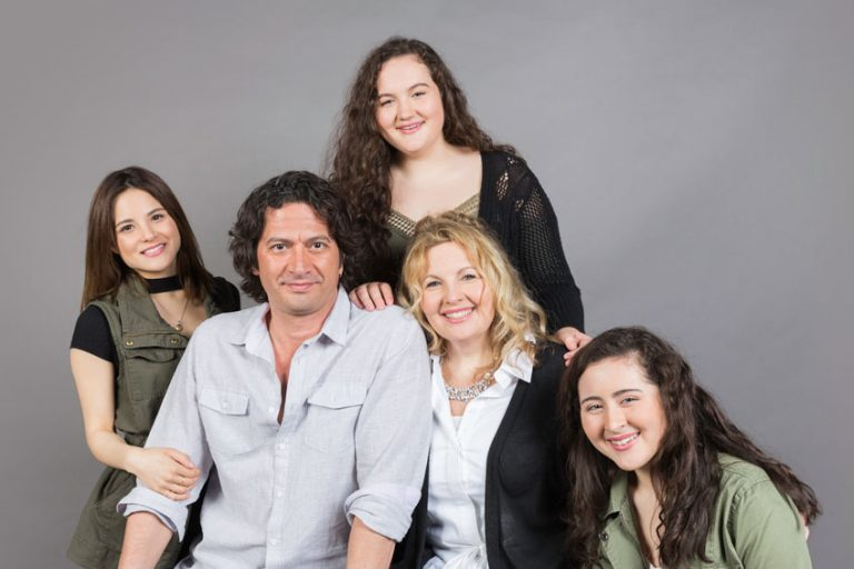 Shara, Sammy and their daughters in studio setting