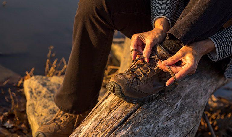 tying hiking boots