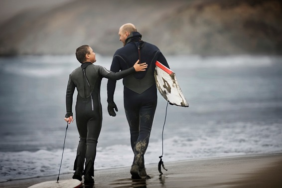 Father and son surfing