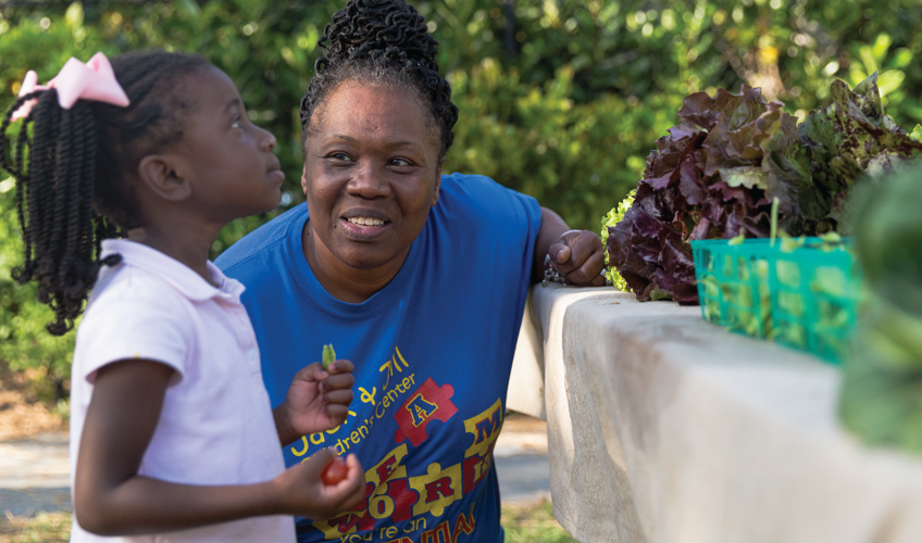 A family selects produce at the Jack and Jill Center
