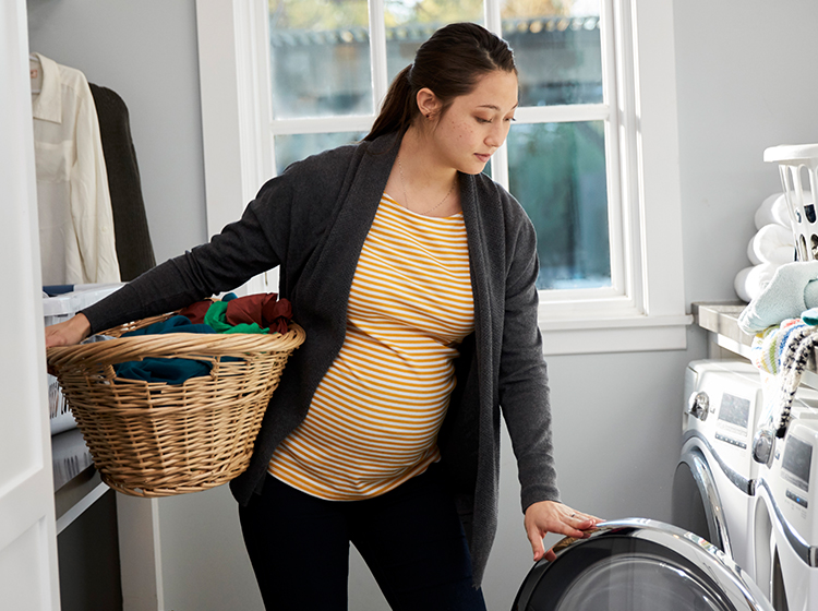 Pregnant woman doing laundry