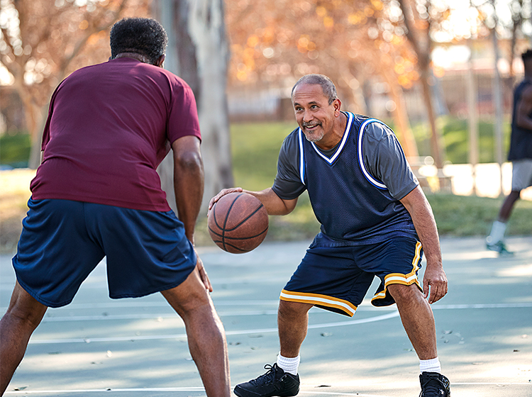 Mature men playing basketball