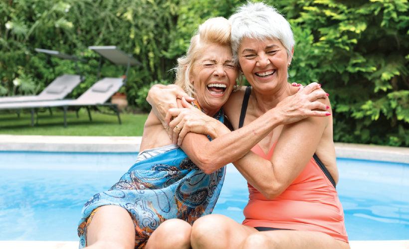 Senior women smiling by the pool