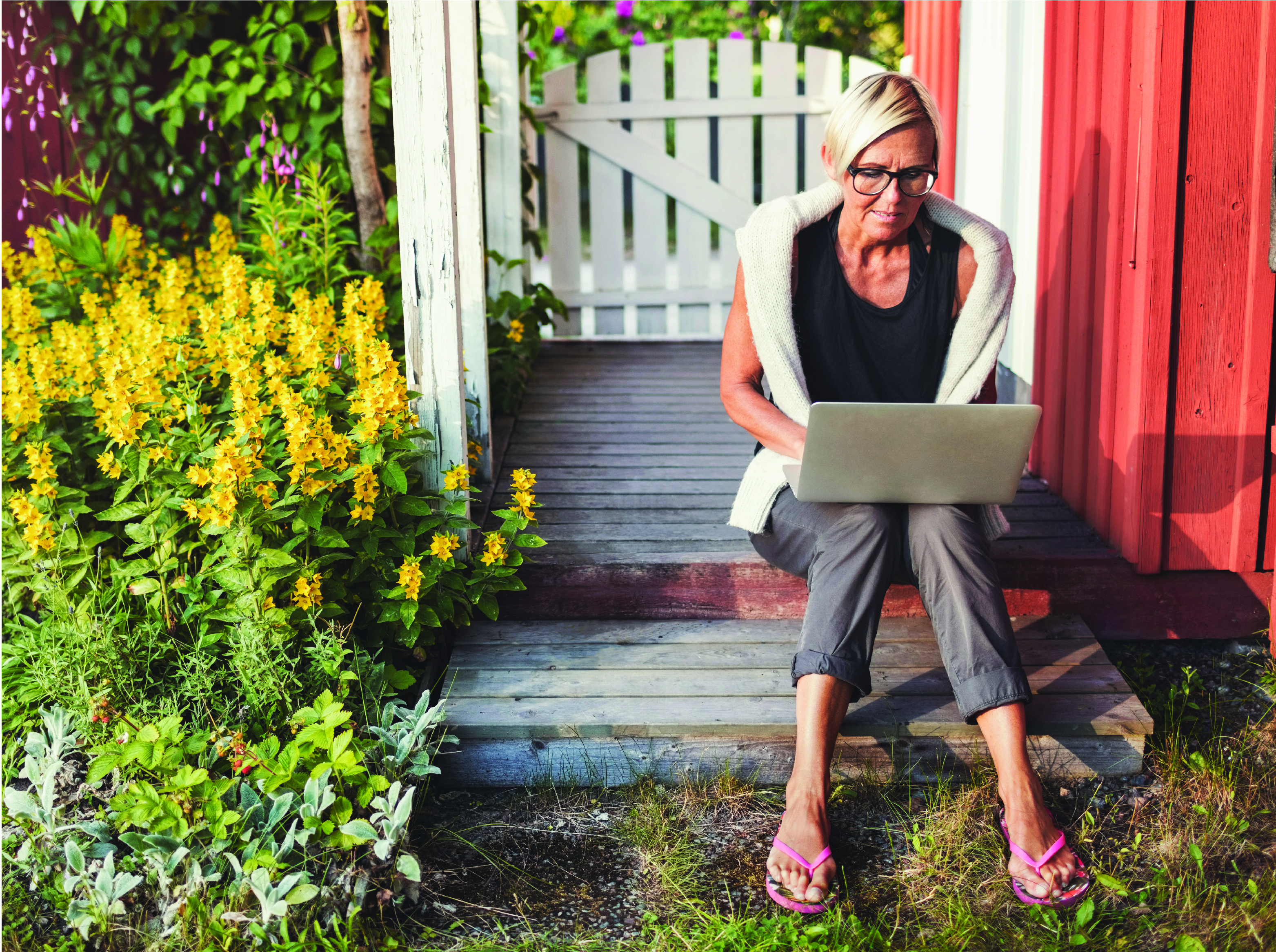 woman using laptop on porch