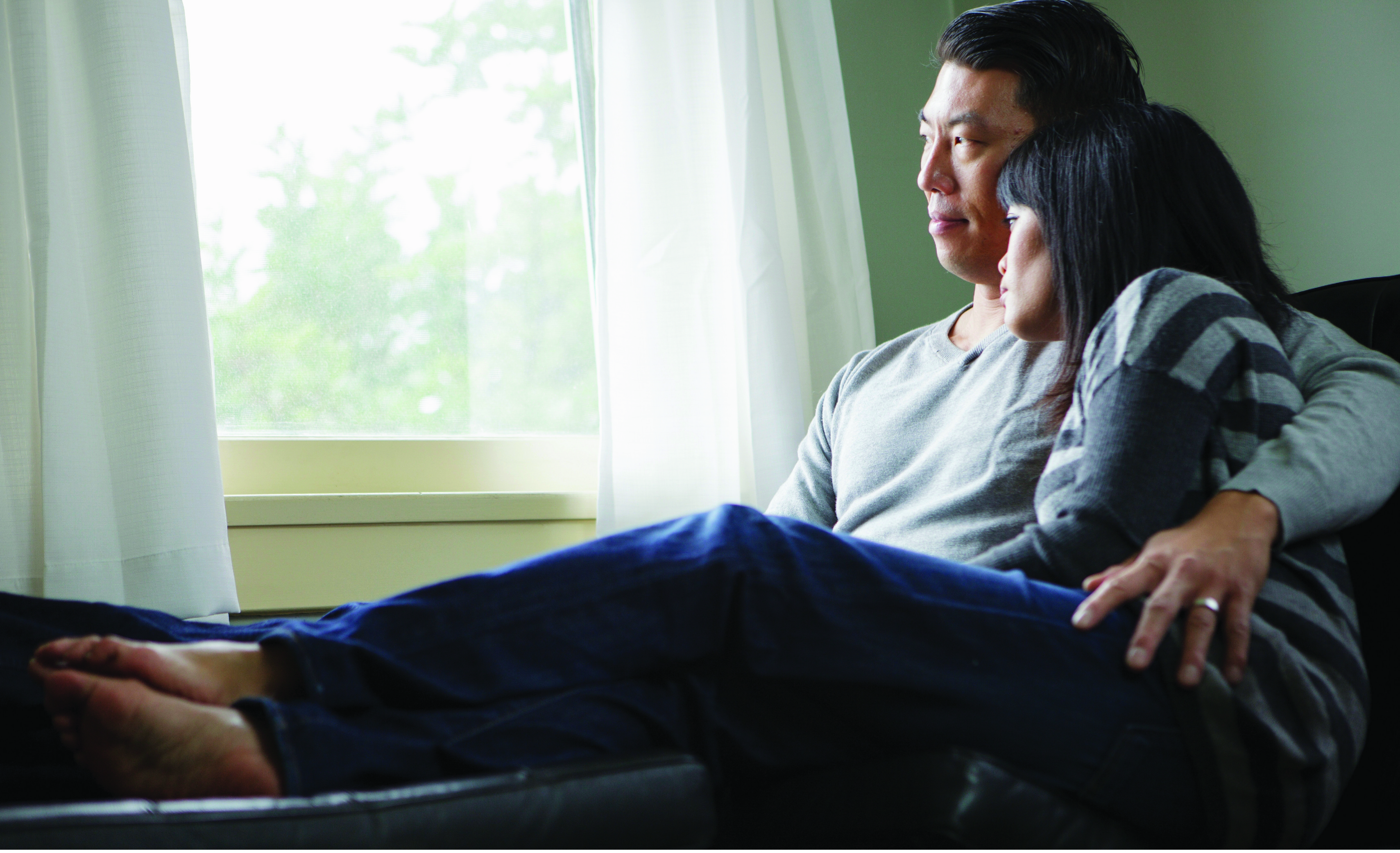 asian couple looking out window
