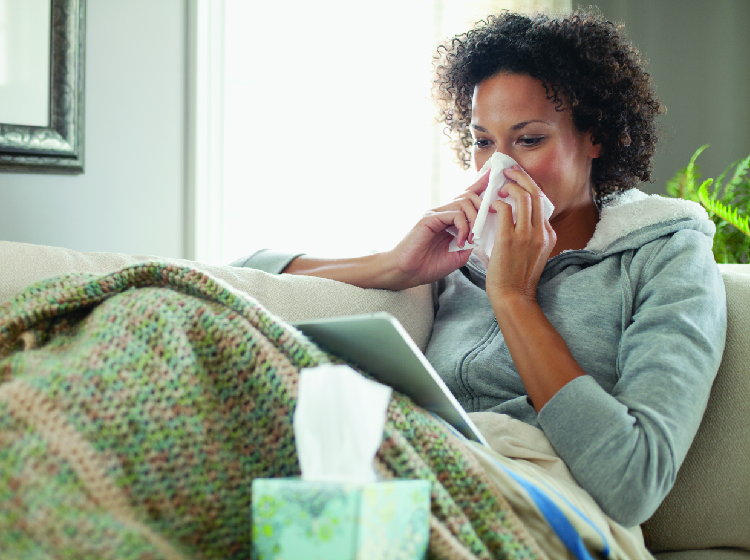 Woman with antibiotics and flu