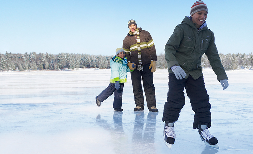 Three people skating on ice