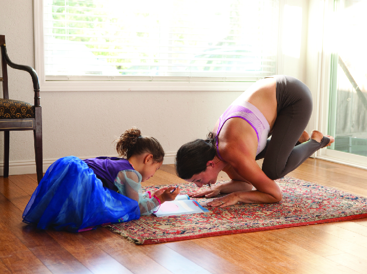 Woman doing yoga and a girl with a book
