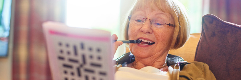 Brain Health - Woman doing crossword puzzle