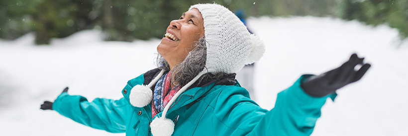 woman smiling in snow