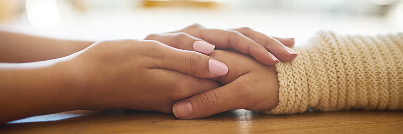 women holding hands