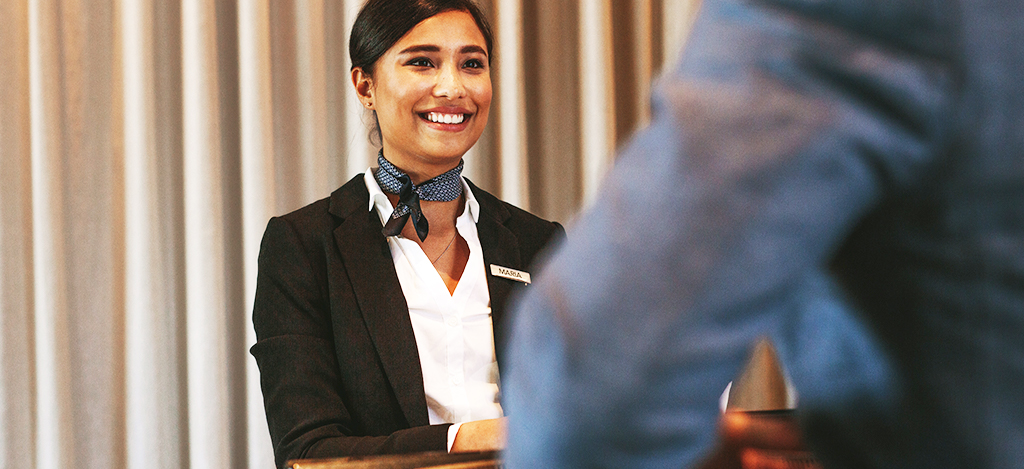 hotel receptionist smiling